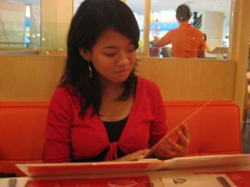 Jasmin looking through the menu